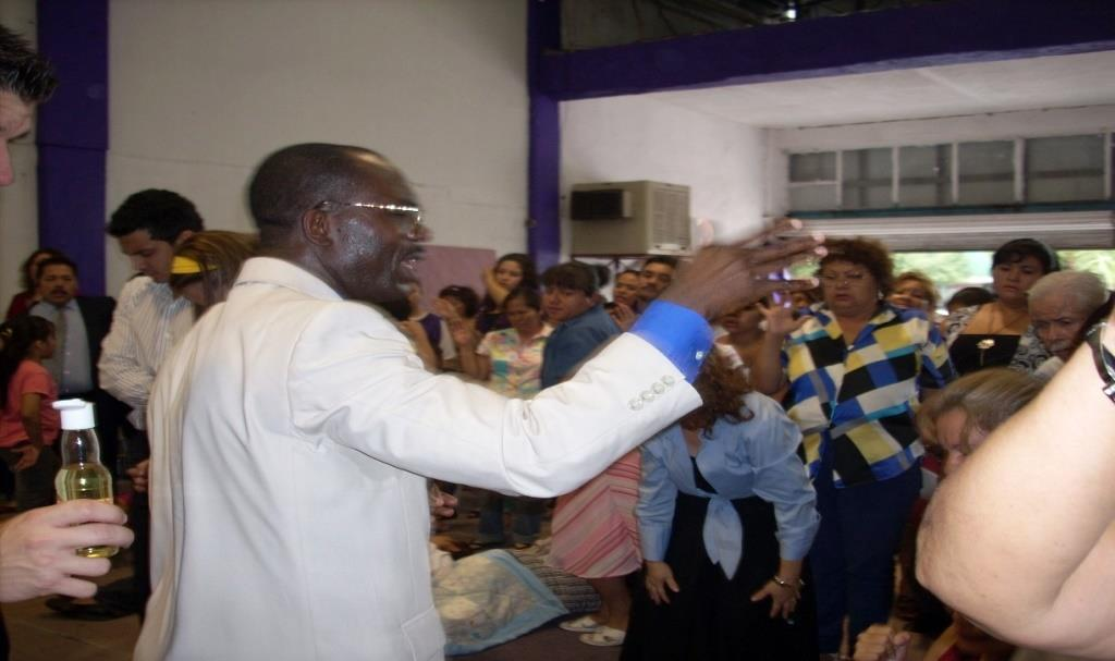 Rev. Dr. Mfon ministering to the body of Christ in Mexico