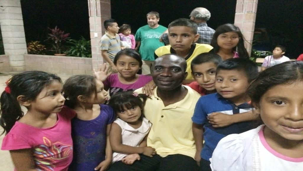 Dr. Mfon Archibong and young children in El-Salvador