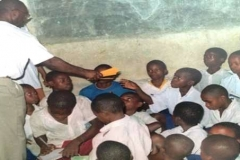 Dr. Mfon Archibong distributing school materials to Secondary school students in Nigeria