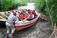 Dr. Mfon reaching out to poorest villages during medical mission through local made boat